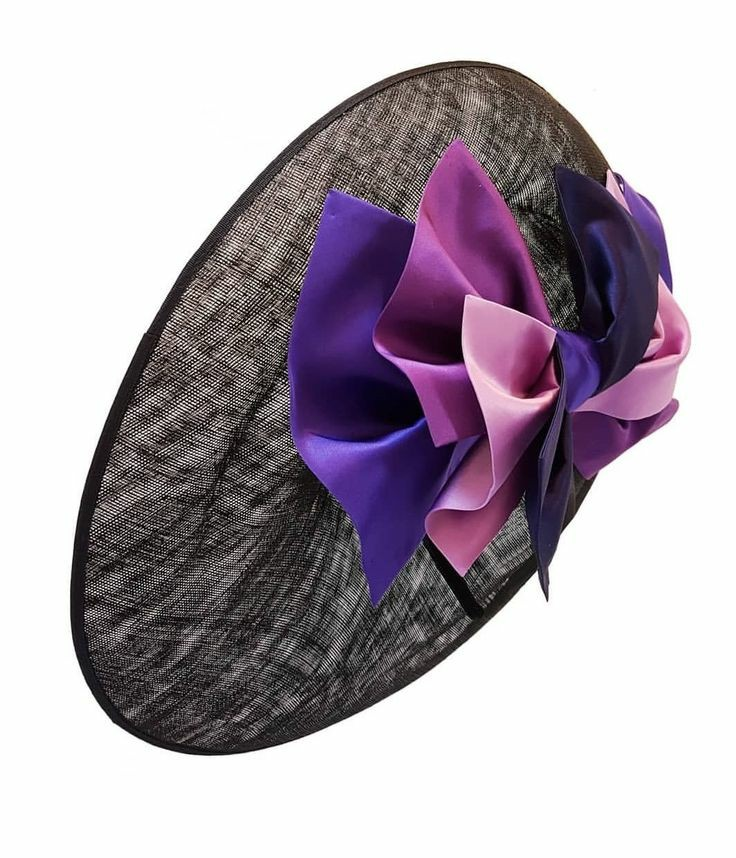 Large side sweep occasion hat with purple bow