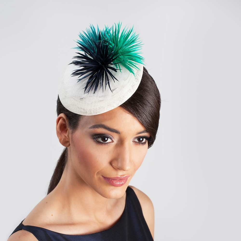 White cocktail hat with spiky silk flowers