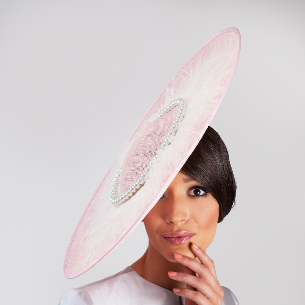 Pale pink side sweep occasion hat with pearl and ostrich halo