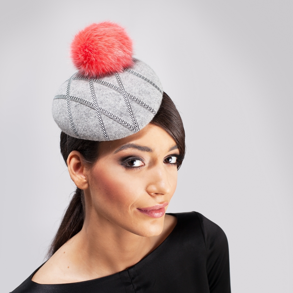 Grey felt cocktail hat with coral pompom