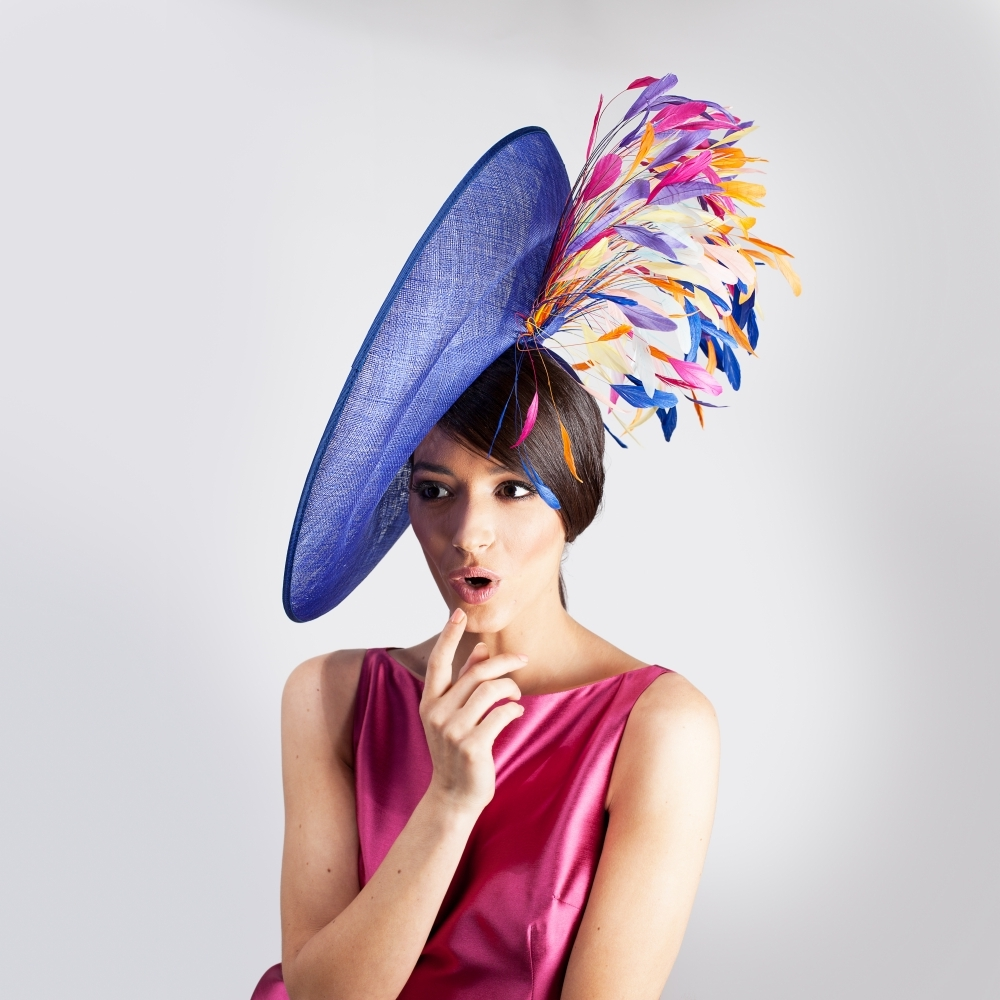 Royal blue statement hat with burst of coloured feathers for race day