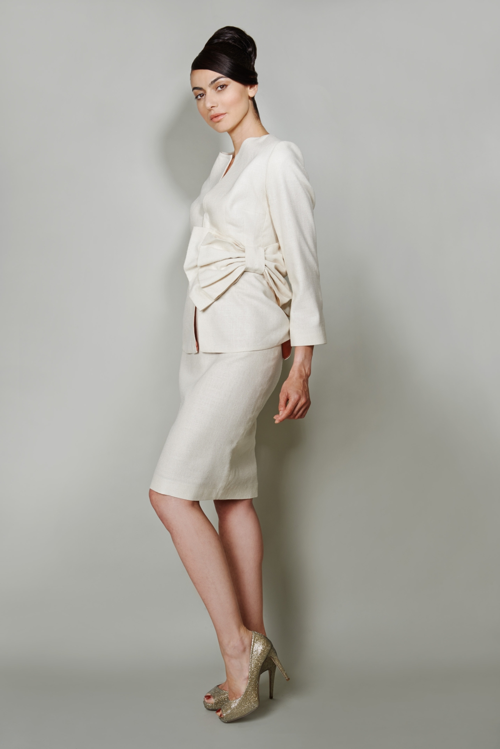 Ivory silk occasion wear suit with bow detail