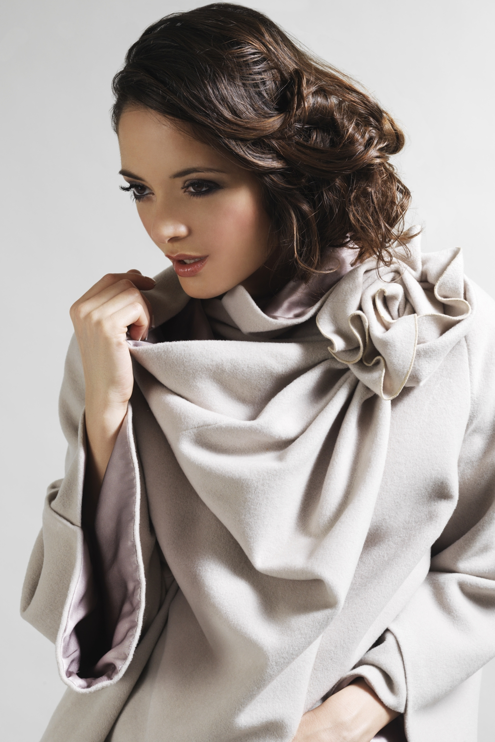 Wool coat with draped flower detail