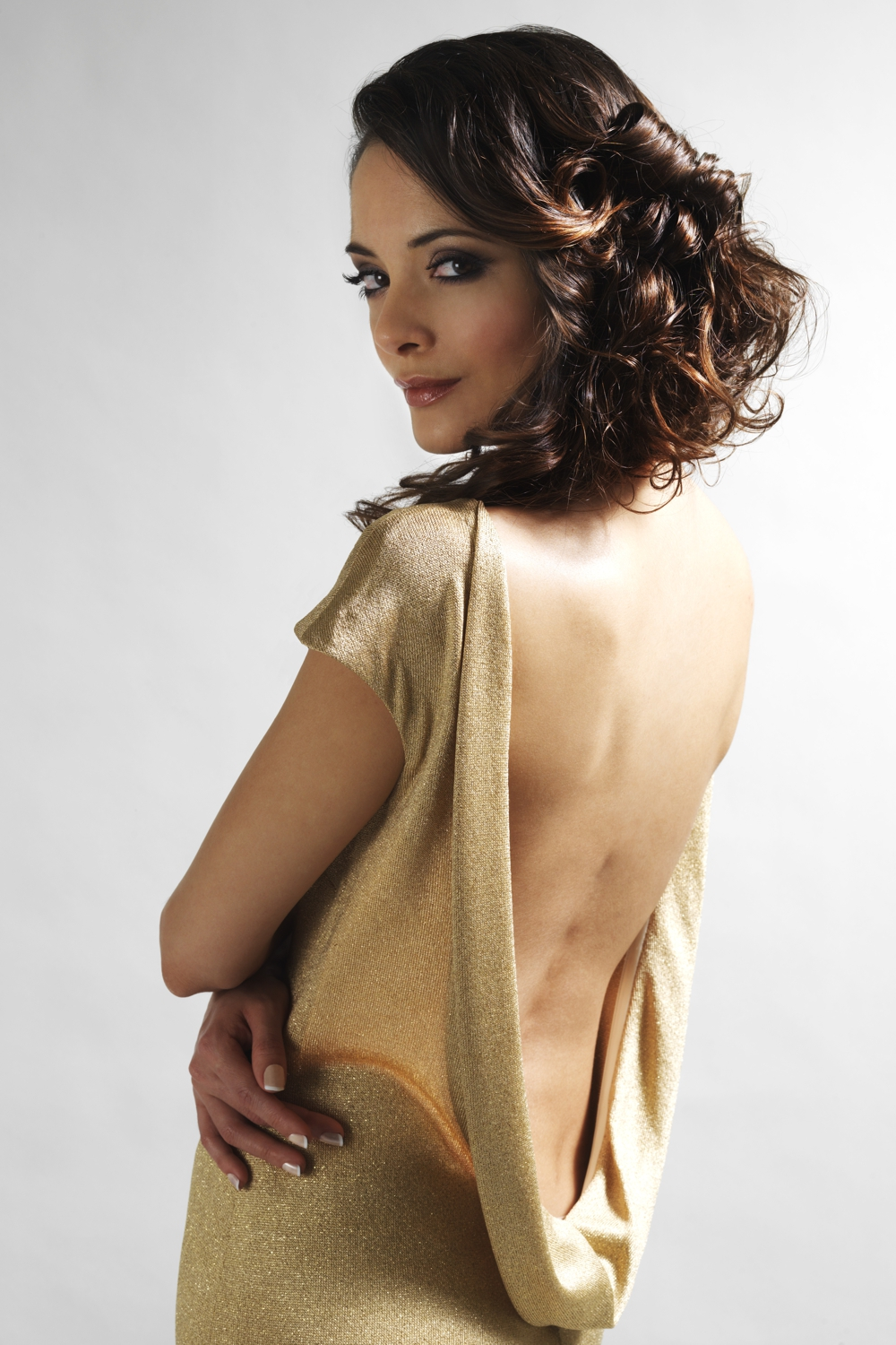 Knitted gold jersey designer gown with open back