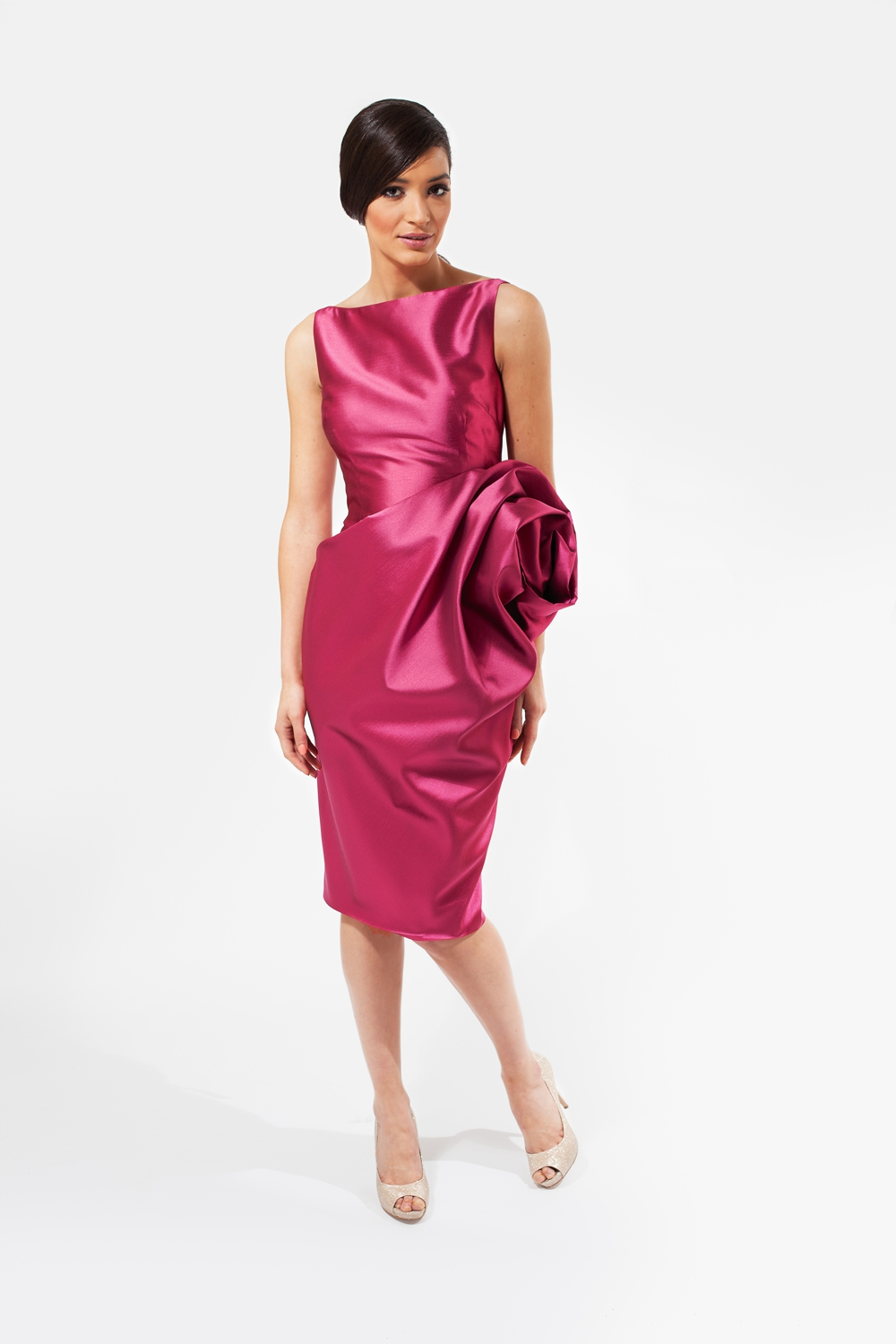 Fuchsia pink designer couture dress with sculptured rose